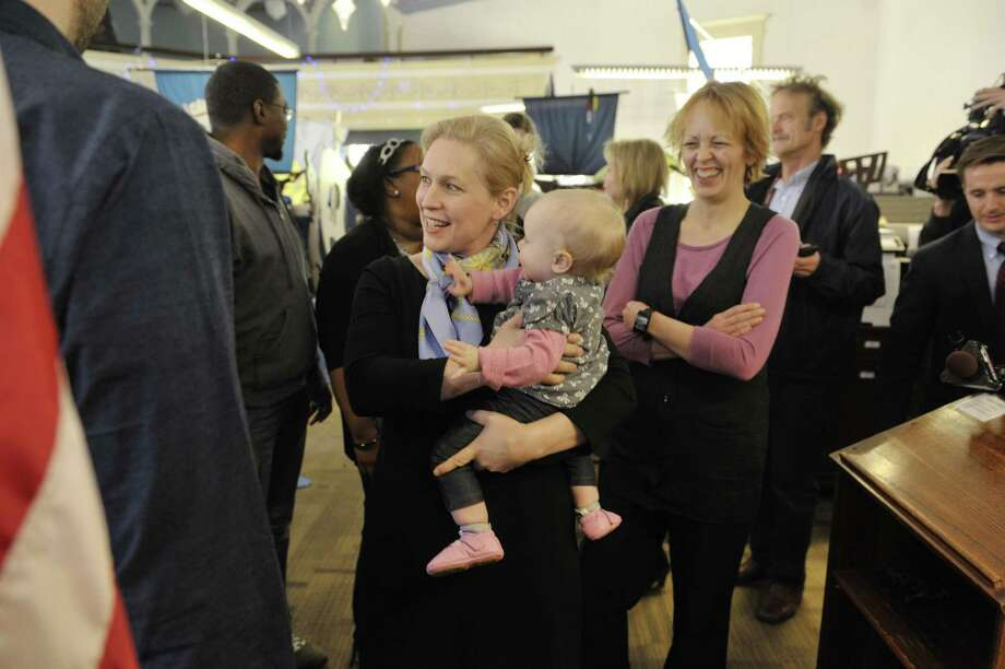 U.S. Sen. Kirsten Gillibrand, left, shown during a 2015 event, is sponsoring legislation to provide family paid leave. She realizes the economy is only as strong as its workers. Photo: Albany Times Union File Photo / 10031283A