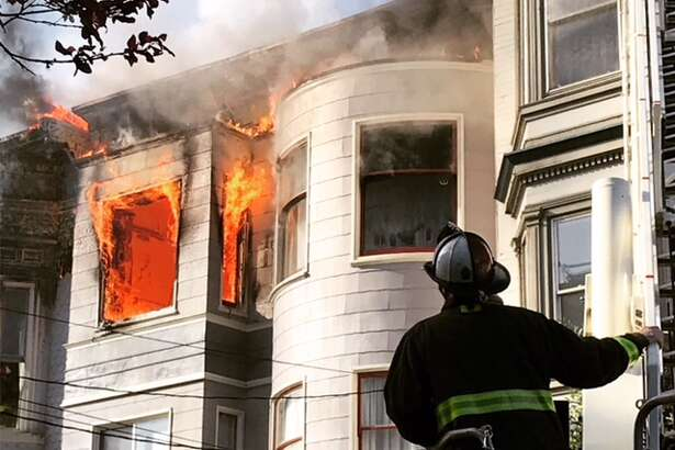 The San Francisco Fire Department responds to a two-alarm fire on Page Street in San Francisco, Calif. on Monday, Feb. 18, 2019.