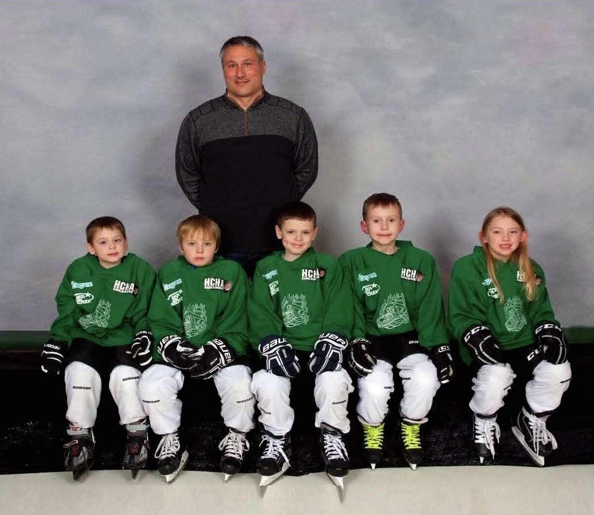 Green-Mini Mites Division 6U. Front row: Logan Bieri, Parker Braun, Gunner Nicholas, Ben Bolzman, Ava Krebs. Back Row: Coach Clint Braun.