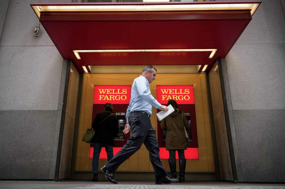 Customers use an ATM machine in front of a Wells Fargo Bank branch in San Francisco, Calif. on Friday, Feb. 8, 2019. Photo: David Paul Morris, Freelance / Special To The Chronicle / ONLINE_YES