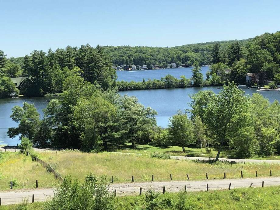 A water test in early April showed that the clarity of the water at Highland Lake is six feet deep. The normal depth for clarity is about 14 feet. Photo: Leslie Hutchison / Hearst Connecticut Media /