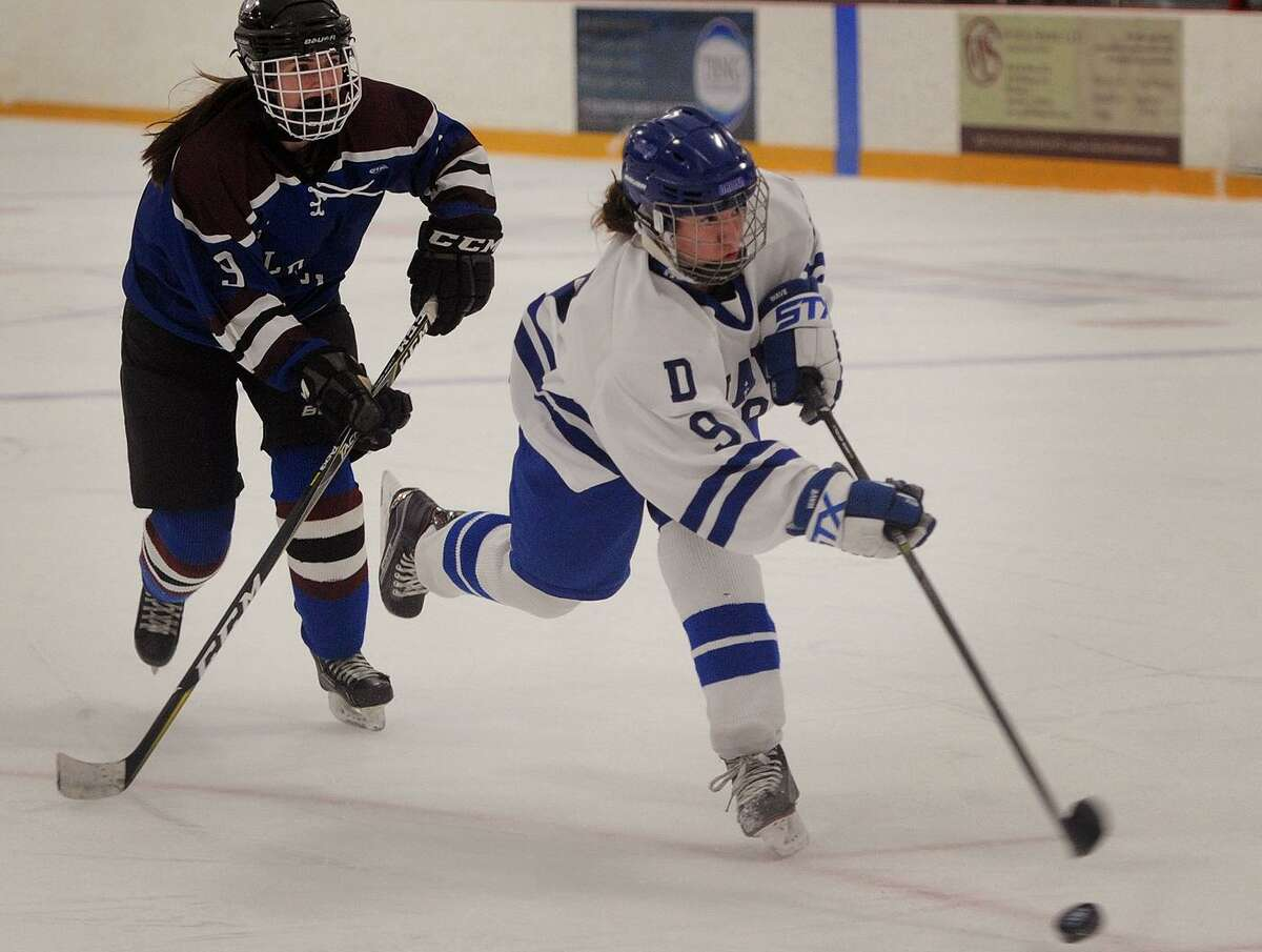 Darien's Kate Bellissimo fires a shot for a goal in the first period of her team's 5-2 victory over Suffield Co-Op in the girls hockey championship at Bennett Rink in West Haven on March 11, 2018. Bellissimo scored in the first meeting of the season against Greenwich, a 2-0 win.