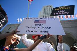 People protest against U.S. President Donald Trump's National Emergency declaration, February 18, 2019, outside City Hall in Los Angeles, California. - The event is part of a nationwide mobilization in response to Trumps's invoking of a national emergency to receive more funding for a border wall along the U.S.-Mexico border. (Photo by Robyn Beck / AFP)ROBYN BECK/AFP/Getty Images