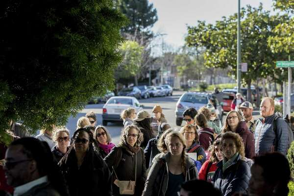 Oakland teachers listen as Oakland Education Association President Keith Brown discusses strike plans at Taylor Memorial Methodist Church.
