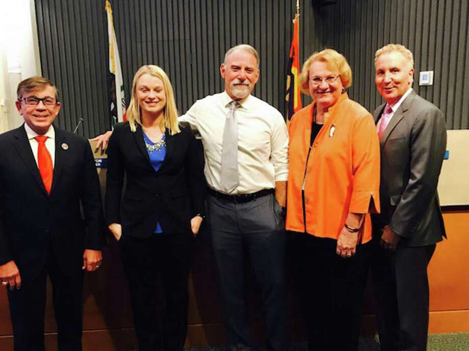 Mayor Robert Moon, left, Christy Holstege, J.R. Roberts, Lisa Middleton and Geoff Kors constitute the Palm Springs, California, City Council, the first in the United States to be all-LGBT. Photo: City Of Palm Springs. / City of Palm Springs