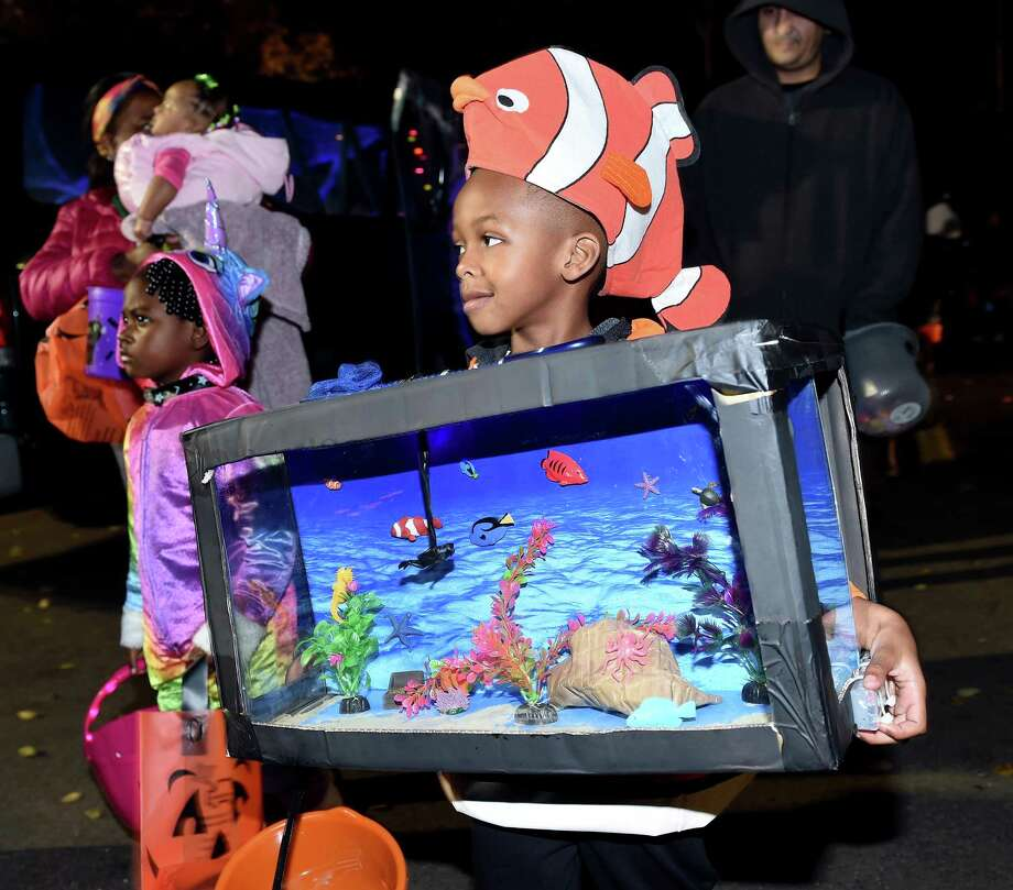 T.J. Relaford, 5, of Hamden dressed as an aquarium gathers candy at the Trunk or Treat event at Edgewood Park in New Haven on Oct. 31, 2018. Photo: Arnold Gold / Hearst Connecticut Media / New Haven Register
