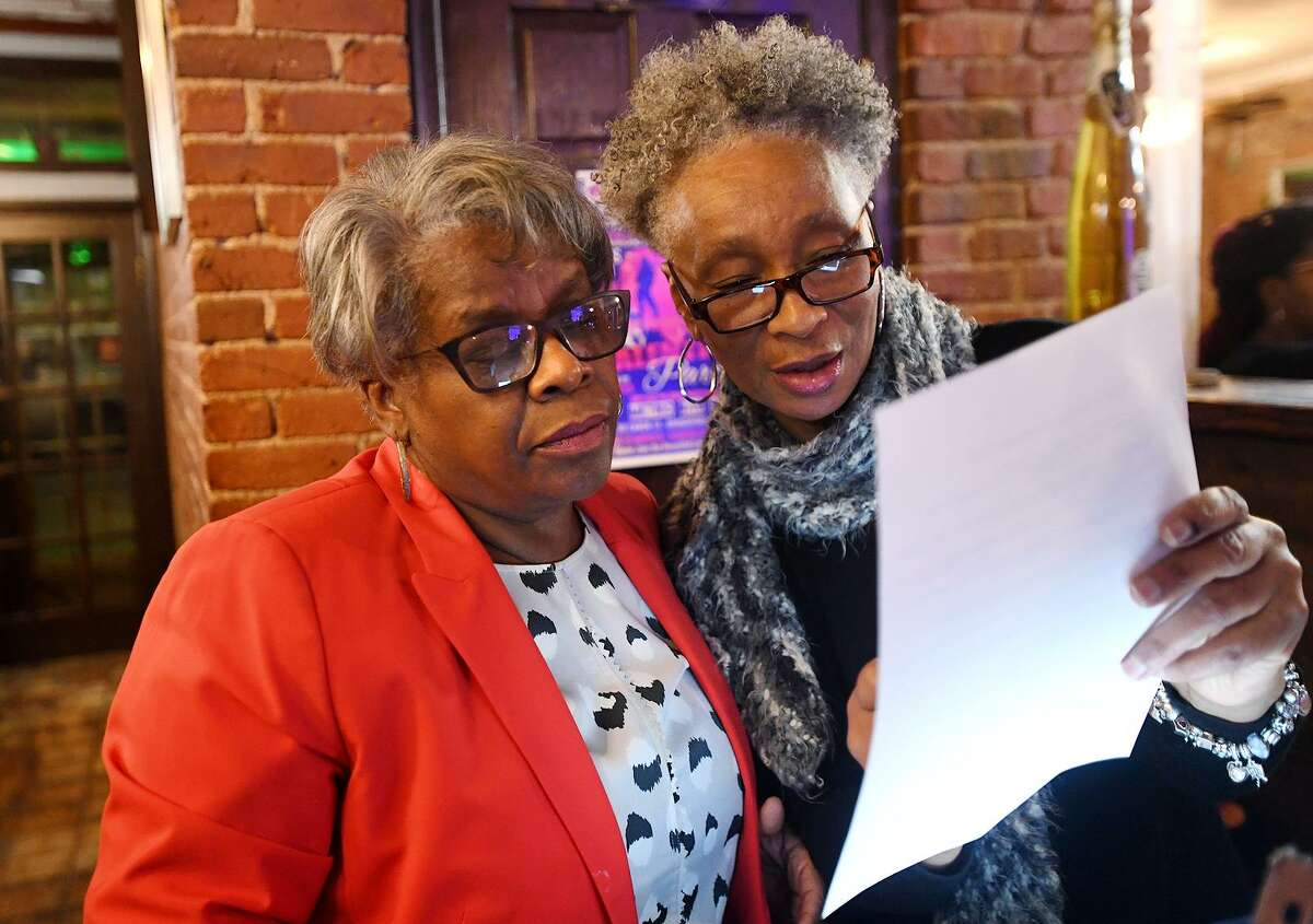 State Senator Marilyn Moore, left, looks over campaign contributions with volunteer Dorothy Lewis, of Bridgeport, during Moore's first fundraiser for her mayoral campaign at Metric Bar and Grill in Bridgeport, Conn. on Monday, February 18, 2019.