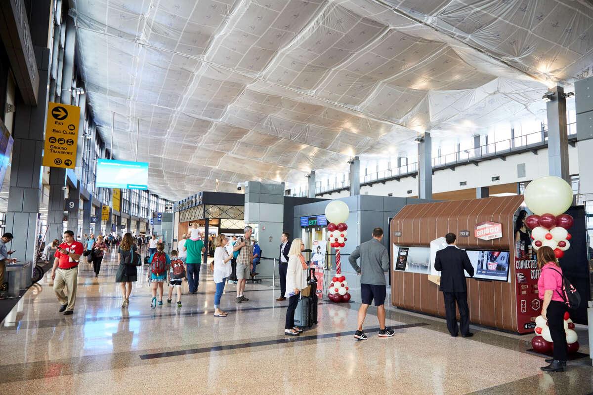 A rendering of a Briggo Coffee Haus kiosk greeting customers at Austin's Bergstrom International Airport.