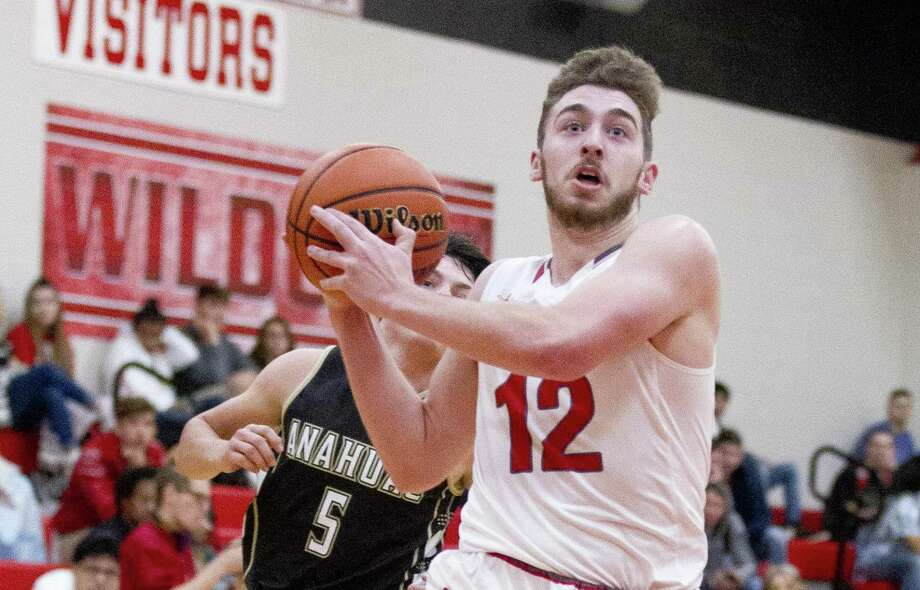 Splendora small forward Ty Broussard (12) drives for a layup in the first quarter of a high school basketball game during the 2018 Splendora Invitational at Splendora High School, Thursday, Nov. 29, 2018, in Splendora. Photo: Jason Fochtman, Houston Chronicle / Staff Photographer / © 2018 Houston Chronicle