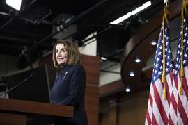 """House Speaker Nancy Pelosi (D-Calif.) responds to reports that President Donald Trump would declare a national emergency to bypass Congress and build his long-promised wall, on Capitol Hill in Washington, Feb. 14, 2019. Pelosi said that Democrats were reviewing options did not rule out a legal challenge. """"The president is doing an end run around Congress,"""" she said. (Sarah Silbiger/The New York Times)"""