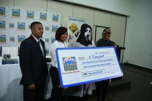 """A jackpot winner in Jamaica wore a mask from the horror movie """"Scream"""" to claim the prize last week. Law changes in Illinois also allow lottery winners to remain anonymous."""