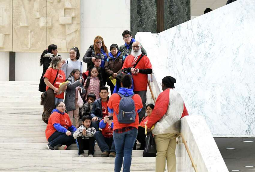 Los Sures Lucha group takes a picture on the stairs of the Legislative Office Building during the New York State Association of Black and Puerto Rican Legislators conference Saturday, Feb. 16, 2019 in Albany, NY. (Phoebe Sheehan/Times Union)