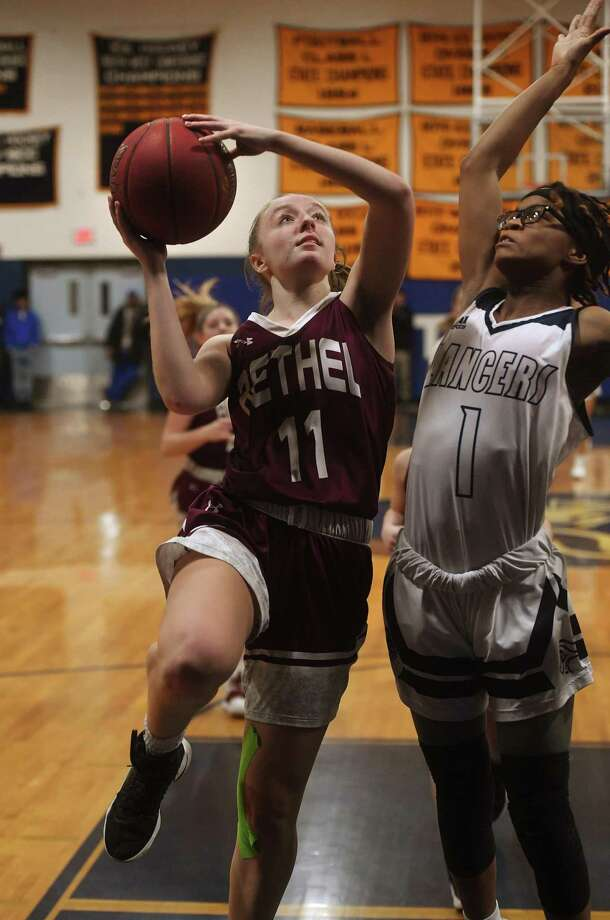 Bethel's Vicky Gracy drives to the basket against Notre Dame of Fairfield defender Yamani McCollough in the first half of their matchup in the SWC girls basketball tournament at Notre Dame High School in Fairfield, Conn. on Monday, February 18, 2019. Photo: Brian A. Pounds / Hearst Connecticut Media / Connecticut Post