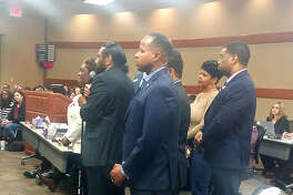 Fort Bend elected officials stand in solidarity alongside Congressman Al Green as he speaks during public comment at a Fort Bend ISD school board meeting on Feb. 18, where he implored the school district to respect the 95 African-American remains.