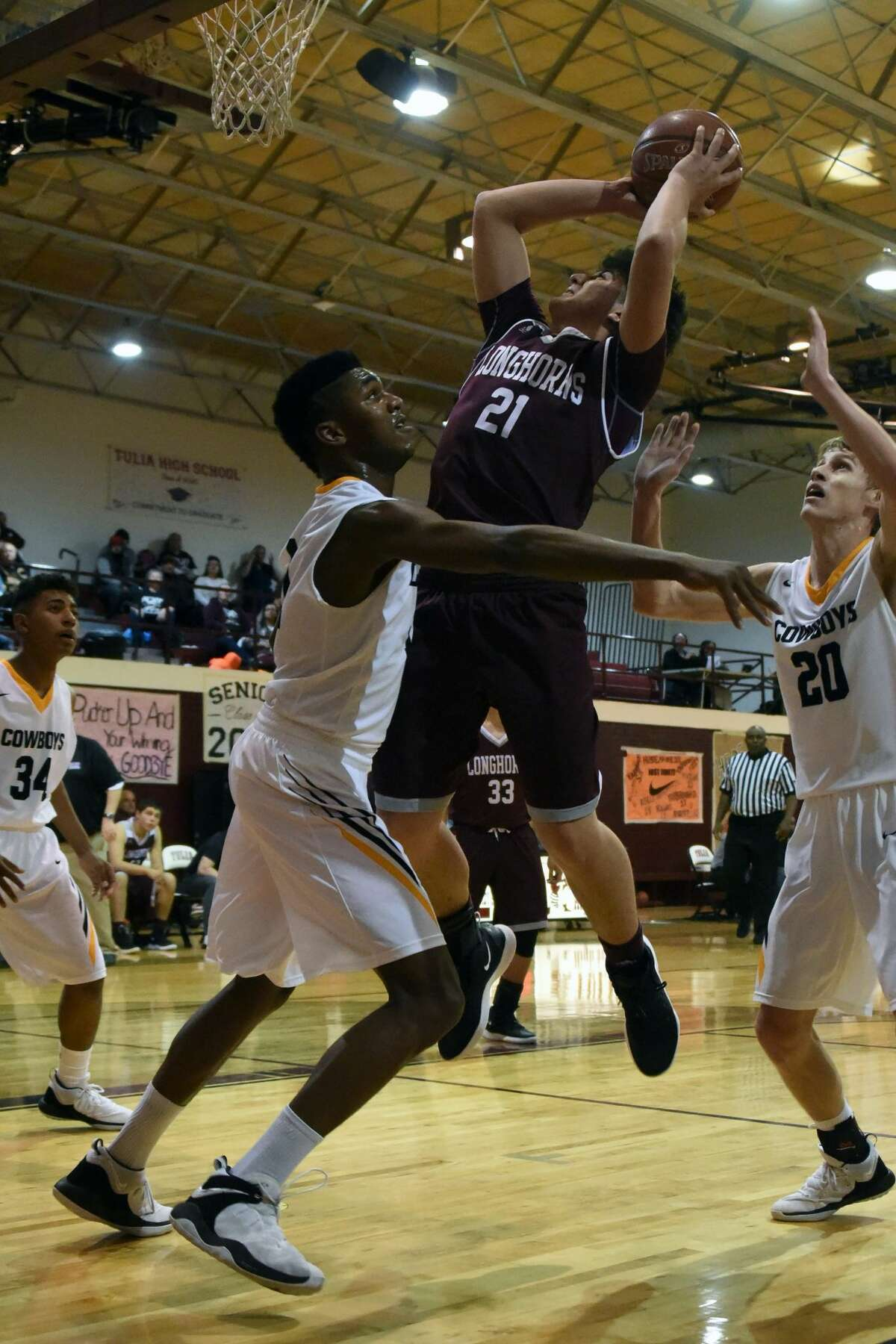 The TABC Class 1A No. 18-ranked Happy Cowboys eliminated the Hart Longhorns from the playoffs with a 76-46 Bi-District win on Monday night in Tulia.