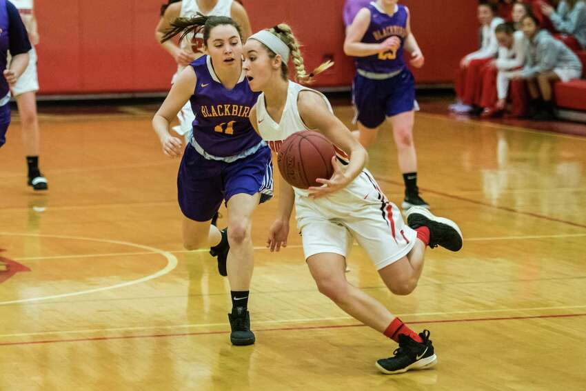 Tamarac 's Emily Erickson steals the ball from Voorheesville's Amelia Rowland as the teams faced off at Tamarac High School in Troy, NY Tuesday January 22nd, 2019