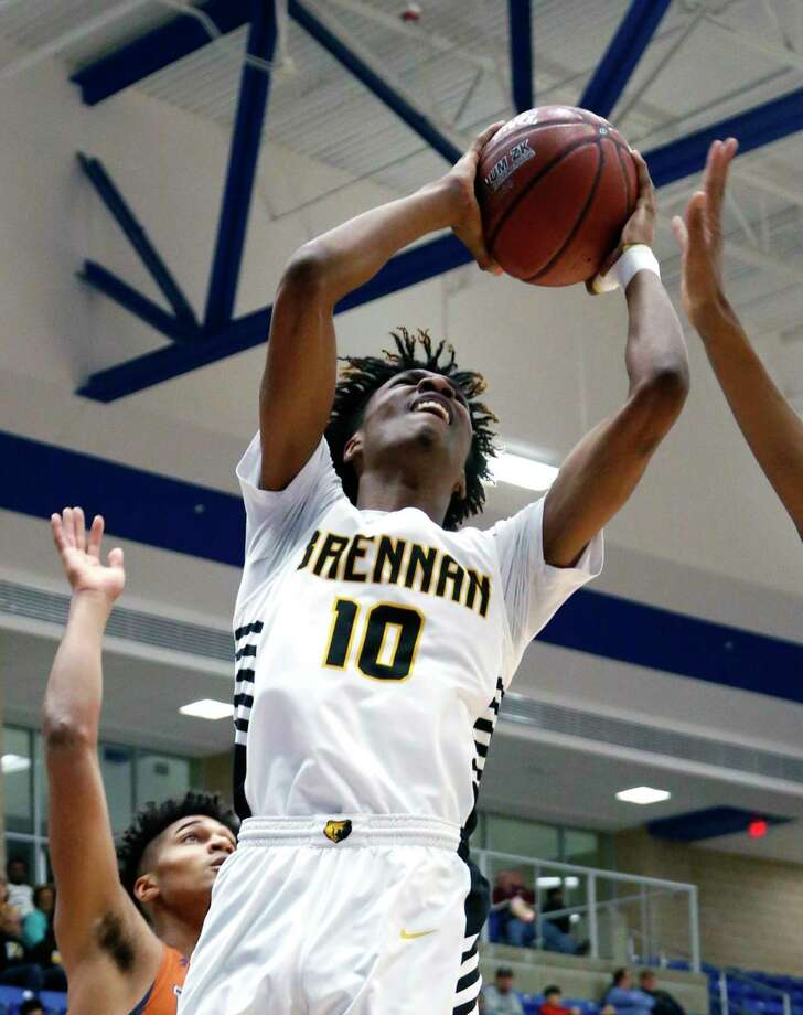 Brennan's Norman Beckford shoots against Madison from the UIL Class 6A bidistrict high school boys basketball contest between Brennan and Madison at Northside ISD Gym.on Monday, February 19, 2019. Photo: Ronald Cortes/Contributor / 2018 Ronald Cortes