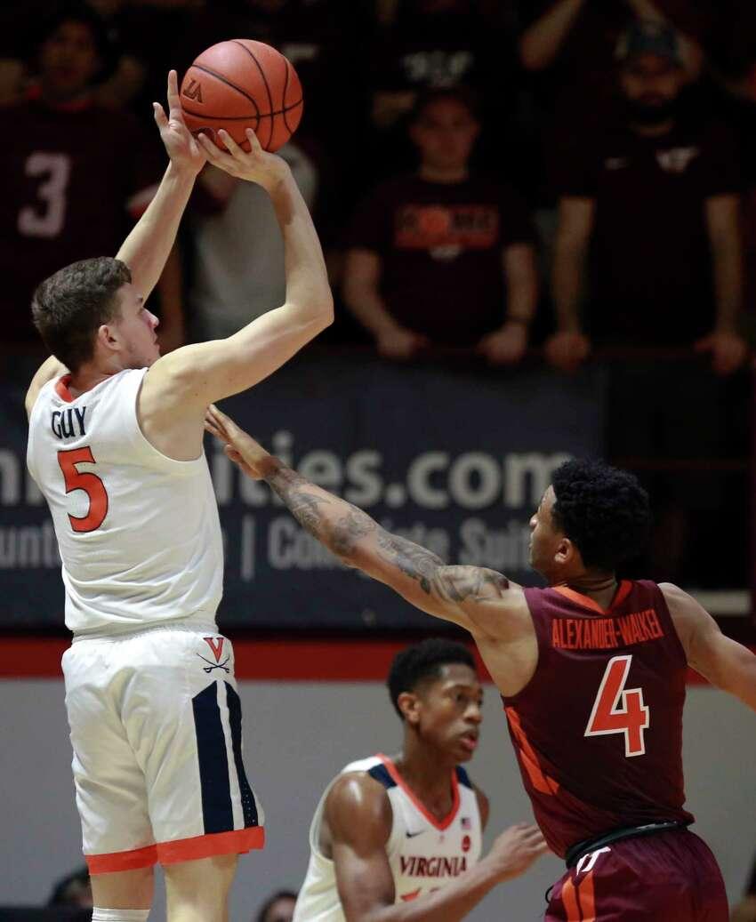 Kyle Guy (5) of Virginia shoots a three-point basket over Nickeil Alexander-Walker (4) of Virginia Tech in the second half of an NCAA college basketball game in Blacksburg Va., Monday, Feb. 18, 2019. (Matt Gentry/The Roanoke Times via AP)