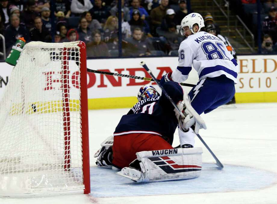 Tampa Bay Lightning forward Nikita Kucherov, right, of Russia, scores past Columbus Blue Jackets goalie Joonas Korpisalo, of Finland, during the first period of an NHL hockey game in Columbus, Ohio, Monday, Feb. 18, 2019. (AP Photo/Paul Vernon) Photo: Paul Vernon / Copyright 2019 The Associated Press. All rights reserved