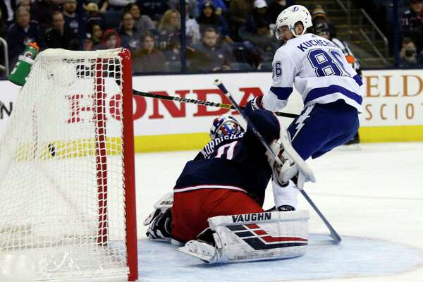 Tampa Bay Lightning forward Nikita Kucherov, right, of Russia, scores past Columbus Blue Jackets goalie Joonas Korpisalo, of Finland, during the first period of an NHL hockey game in Columbus, Ohio, Monday, Feb. 18, 2019. (AP Photo/Paul Vernon)