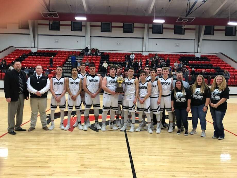 The Forsan boys basketball team poses with its Class 2A bi-district championship trophy at Colorado City High School on Monday night. Photo: Courtesy Photo