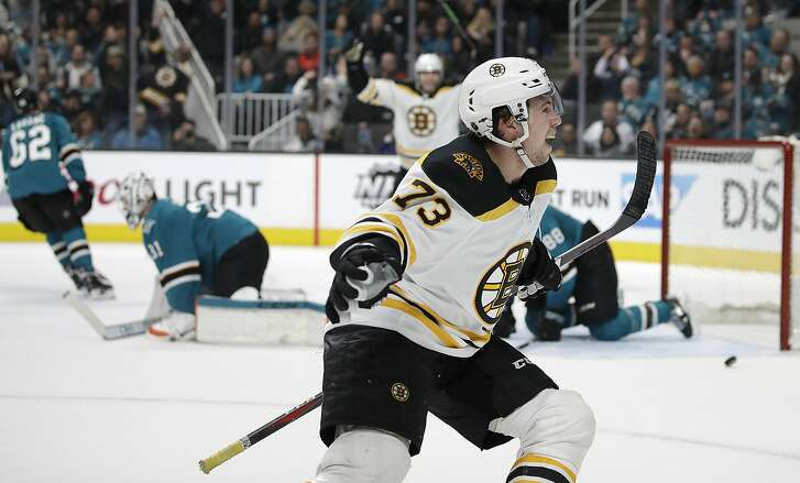 Boston Bruins' Charlie McAvoy (73) celebrates after scoring the game winning goal against the San Jose Sharks in overtime of an NHL hockey game Monday, Feb. 18, 2019, in San Jose, Calif. (AP Photo/Ben Margot)
