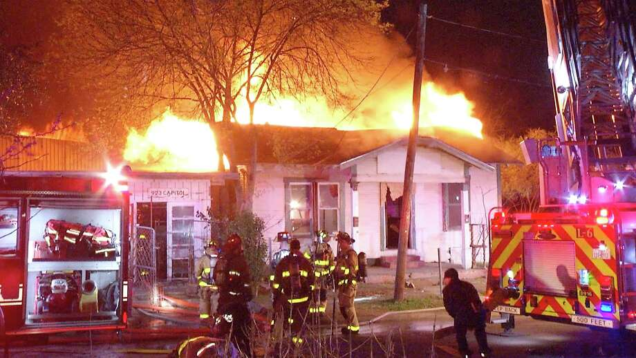 Firefighters responded to the blaze just after 1:20 a.m. in the 900 block of Capitol Avenue. When they arrived, as many as three structures were aflame. Photo: Ken Branca