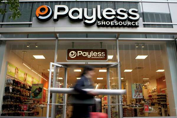 A pedestrian passes in front of a Payless ShoeSource store in New York on May 2, 2012.
