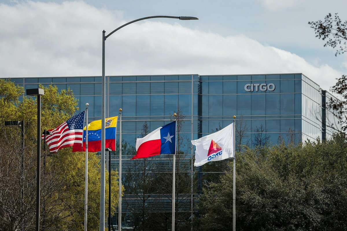 Flags fly outside Citgo Petroleum Corp. headquarters stands in Houston, Texas, U.S., on Thursday, Feb. 14, 2019. NEXT: See the world's largest oil refineries.