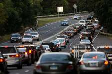 Rush hour traffic backs up in the northbound lanes of the Merritt Parkway near the Black Rock Turnpike exit in Fairfield, Conn. on Tuesday October 1, 2013.