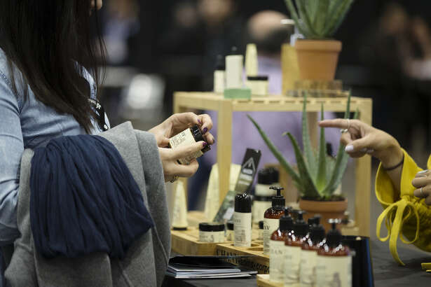An attendee browses hemp oil skin care products at the Montreal Cannabis Expo in Montreal on Oct. 26, 2018.