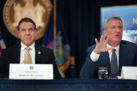 FILE -- Gov. Andrew Cuomo, left, and Mayor Bill de Blasio during the news conference announcing Amazon's second headquarters coming to Long Island City, in New York, Nov. 13, 2018. The company, long accustomed to deferential treatment from localities, badly misjudged how it would be received in the city, according to dozens of interviews. (Chang W. Lee/The New York Times)