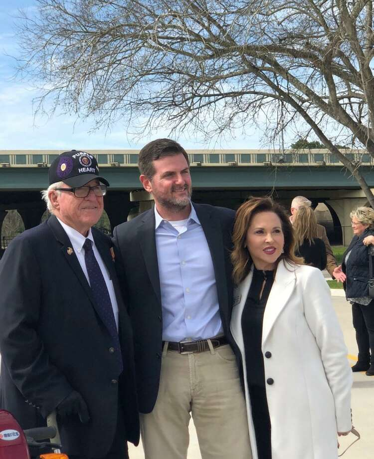 Retired United States Marine Corps Cpl. Jimmie Edwards along with Sen. Brandon Creighton and Judy Duroy with the Montgomery County Veterans Memorial Commissioner celebrated the opening of Freedom Boulevard Monday. Photo: Courtesy Photo