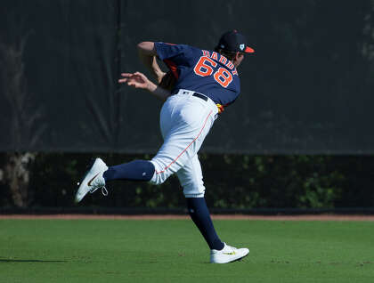 f7c53520003 Houston Astros right handed pitcher Forrest Whitley (68) got a new jersey  for the day at Fitteam Ballpark of The Palm Beaches on Day 6 of spring  training on ...