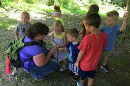Children spending time outdoors with the Nature Institute to promote a healthy lifestyle.