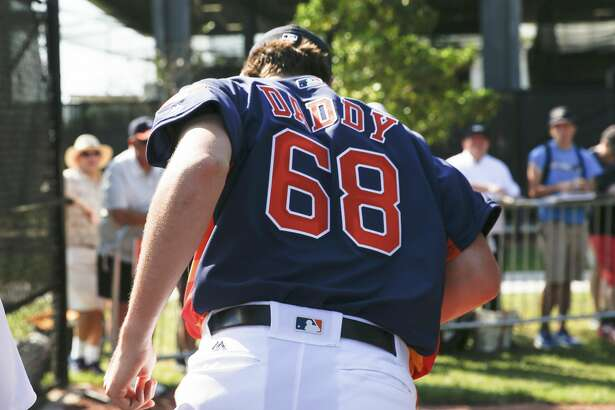 Houston Astros right handed pitcher Forrest Whitley (68) got a new jersey for the day at Fitteam Ballpark of The Palm Beaches on Day 6 of spring training on Tuesday, Feb. 19, 2019, in West Palm Beach.