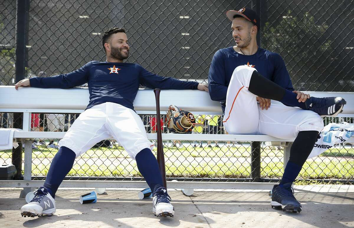 Injuries robbed Jose Altuve, left, and Carlos Correa of plenty of games in 2018. The Astros' middle infield duo looks to make up for lost time this season.
