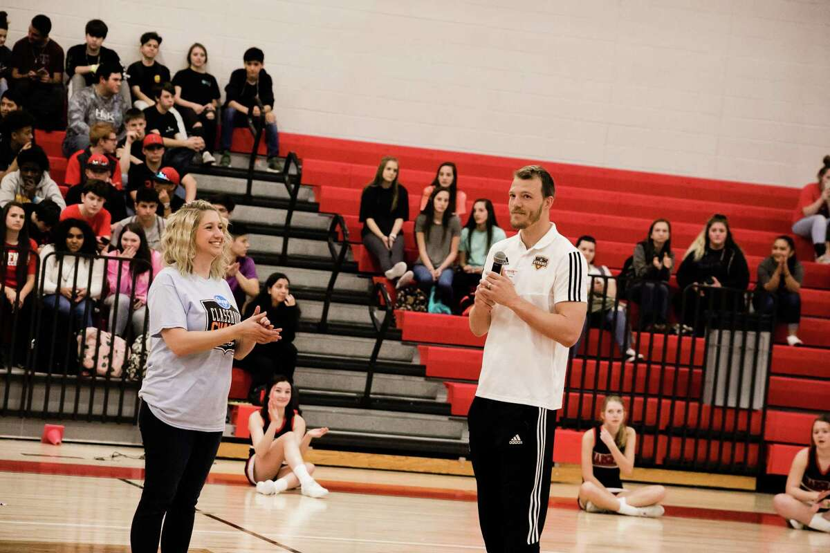 Cristina Sizemore and Joe Willis speak to the crowd during the pep rally on Feb. 15