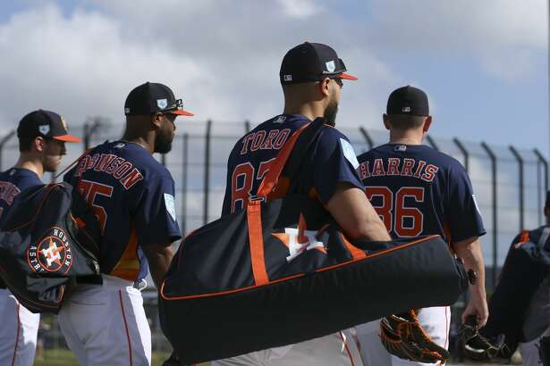Houston Astros players head toward the fields to start the first full-squad practice at Fitteam Ballpark of The Palm Beaches on Monday, Feb. 18, 2019, in West Palm Beach.