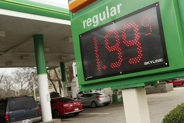 In this Jan. 8, 2019, file photo drivers fill up at the BP station on Prince Avenue in Athens, Ga.