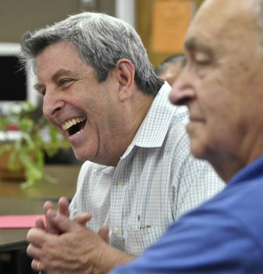 Bob Becker, of Bethel, reacts to a members comments on a story from a member of a weekly memoir writing class, at the Bethel Senior Center. Becker is the facilitator of the class. Photo: H. John Voorhees III / Hearst Connecticut Media / 2016 File Photo / The News-Times