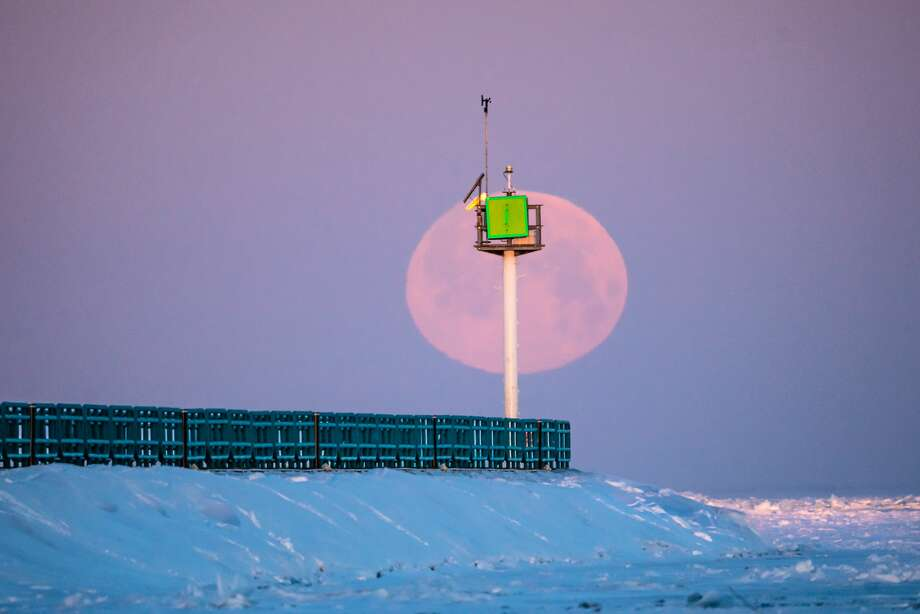Tuesday featured the biggest full moon of the year. This picture was taken Tuesday morning, as the sun just reached the end of the Caseville break wall. Photo: Tyler Leipprandt, Michigan Sky Media/For The Tribune