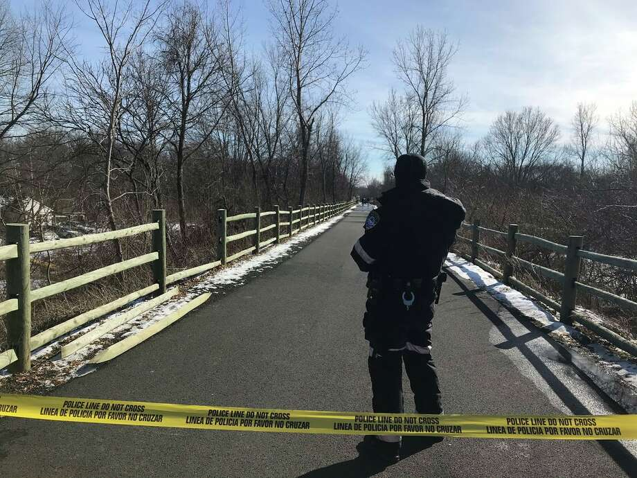 """Linear Trail in Cheshire is blocked off from the Schoolhouse Road intersection to the southern end of the West Johnson Road overpass. Cops on scene say they are investing """"an untimely death."""" Photo: Luther Turmelle / Hearst Connecticut Media"""
