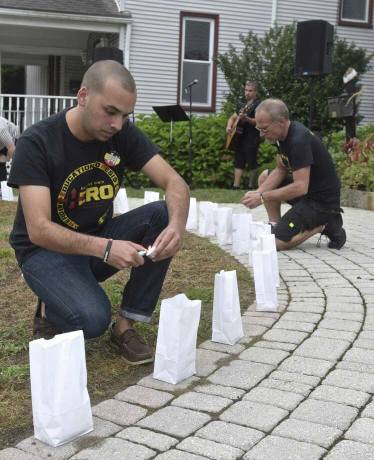 Raghib Allie-Brennam, vice president of The Heroin and Opiate Awareness Project (HERO) lights a luminaries with the name of a person who died from their addiction during the groups annual vigil to raise awareness of overdoses. Friday, August 31, 2018, at United Methodist Church, Bethel, Conn. Photo: H John Voorhees III / Hearst Connecticut Media / The News-Times