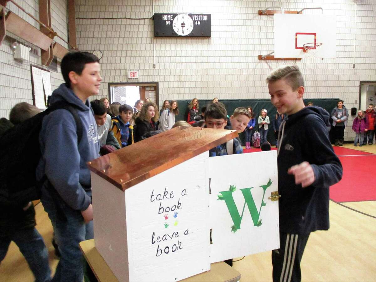 Ian Sideris proudly showed the little free library to his classmates.