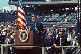 "On Sept. 12, 1962, President John F. Kennedy tells a crowd of about 40,000 at Rice University Stadium in Houston, ""We choose to go to the moon in this decade and do the other things, not because they are easy, but because they are hard."" (NASA)"
