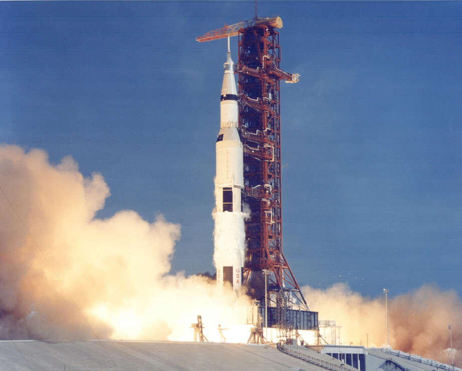 The 363-foot-tall Apollo 11 spacecraft launches at 9:32 a.m. EDT on July 16, 1969 from the Kennedy Space Center in Florida with astronauts Neil A. Armstrong, Michael Collins,and Buzz Aldrin onboard. (NASA)