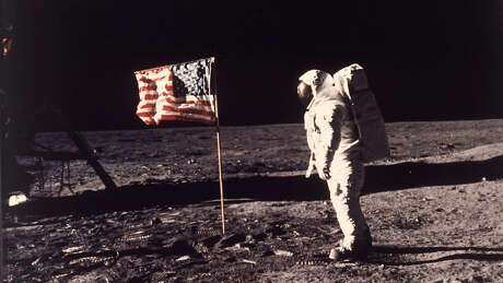 In this July 20, 1969 photo, Astronaut Buzz Aldrin poses beside the U.S. flag on the surface of the moon during the Apollo 11 mission. (Neil Armstrong/Associated Press)