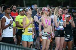 Racers participate in the national anthem during the 6th annual The Woodlands Marathon on Saturday, March 3, 2018, in The Woodlands. This year's events are split into two weekends, with the 2K and 5K races set for Saturday, Feb. 23, and the full marathon and half marathon set for Saturday, March 2. There is a race expo, too, at the Cynthia Woods Mitchell Pavilion on Friday, March 1.