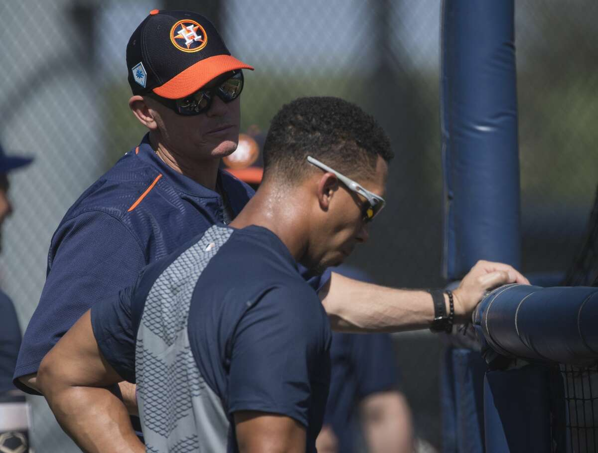 Former Astros great and Hall of Famer Craig Biggio, left, chats with outfielder Michael Brantley during batting practice at Fitteam Ballpark of The Palm Beaches on Tuesday in West Palm Beach, Fla.